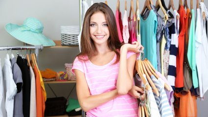 kodus girl sorting clothes in closet